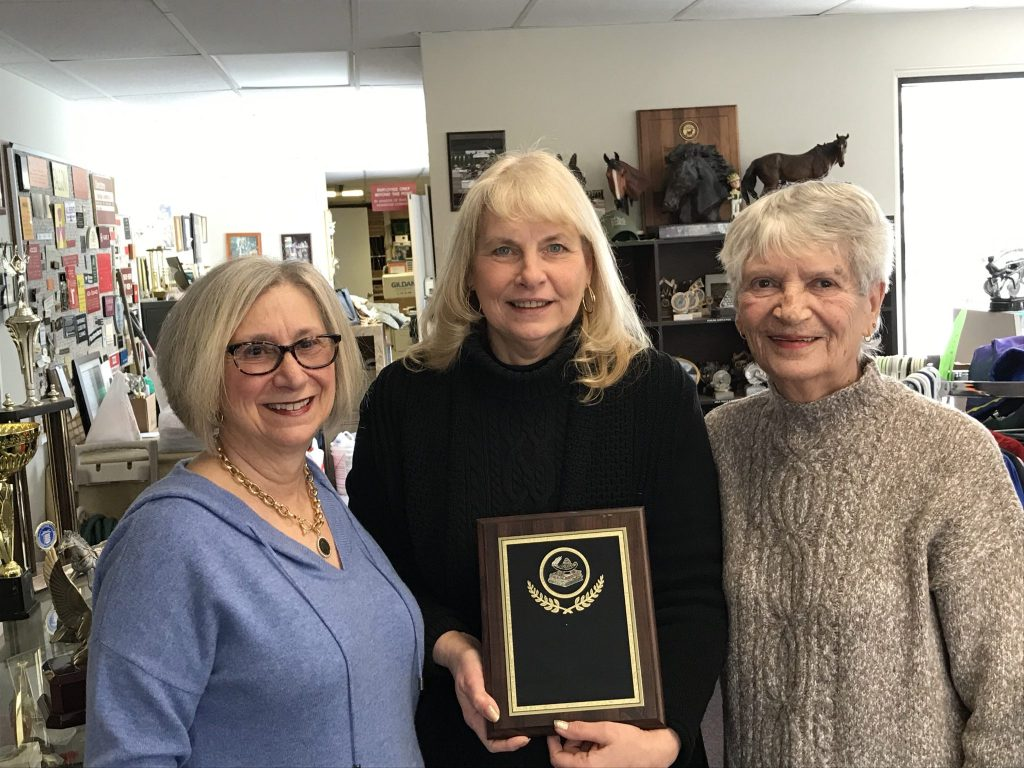 Photo submitted - Picking up plaques at Chancy Tancredi's shop, All Events on Main Street. L to R: Mena Cerone, WCA Board member, Sandy Regan and Dora Czernecki, Board member.