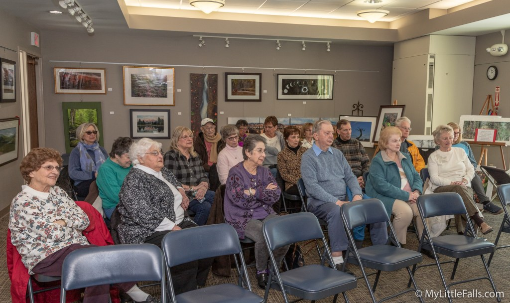 Photo by Dave Warner - The audience listens to Joe DeLorenzo as he plays the piano and sings during a performance at the Little Falls Public Library called Keep you Sunny Side Up.