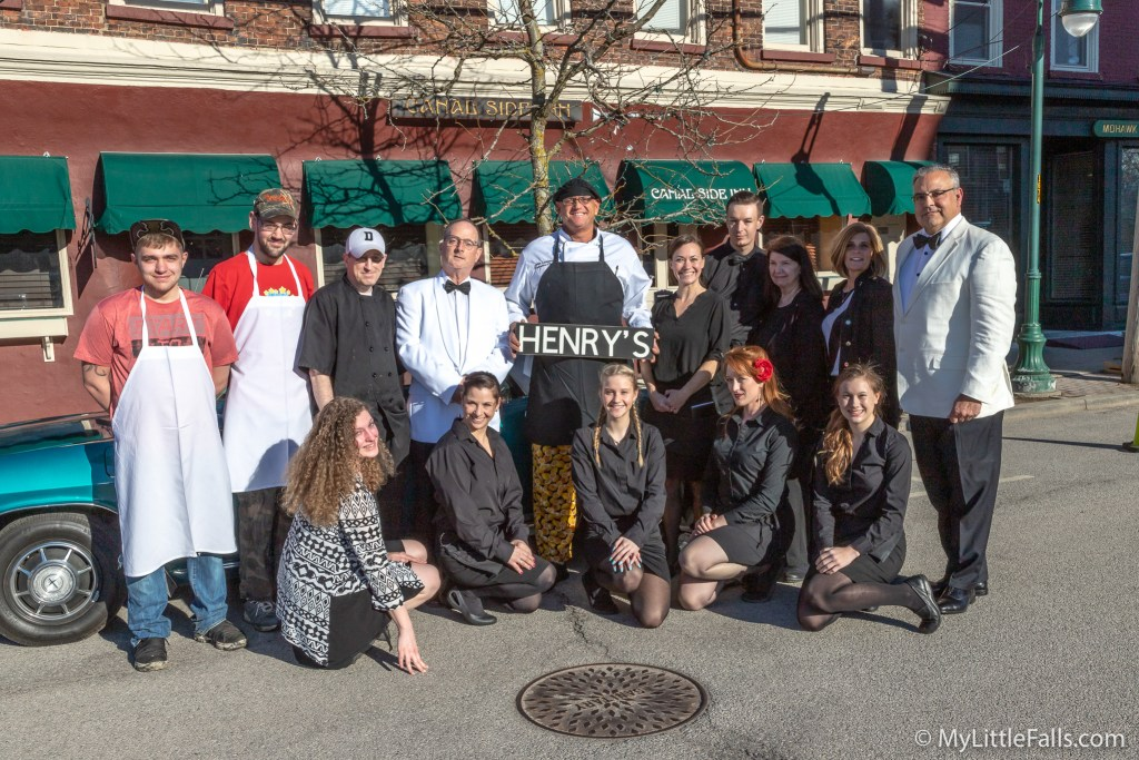 Photo by Dave Warner - Owners and Staff of the Canal Side Inn pose for a picture before opening for Henry's night.