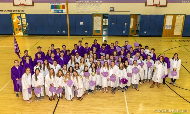 Seniors walk Benton Hall Academy in caps and gowns
