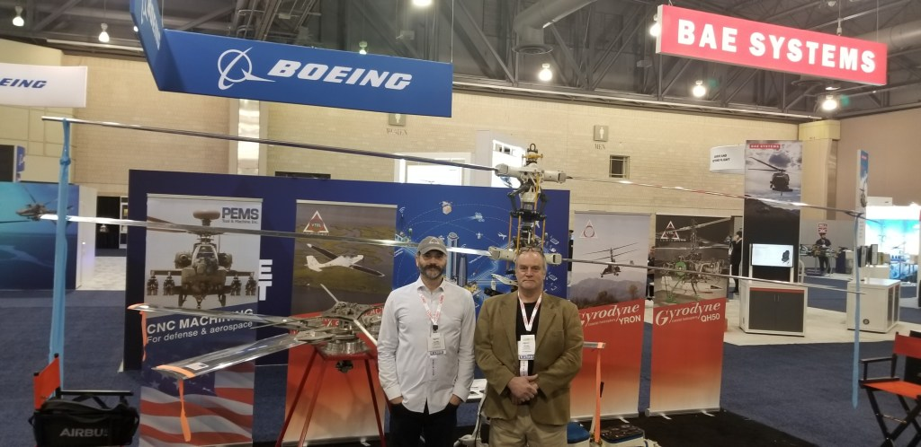 Photo submitted - Daniel Preston (left) and Peter Stone at a recent trade show in Philadelphia, posing by the rotors that were created in Little Falls for the helicopter they are taking to Oshkosh.