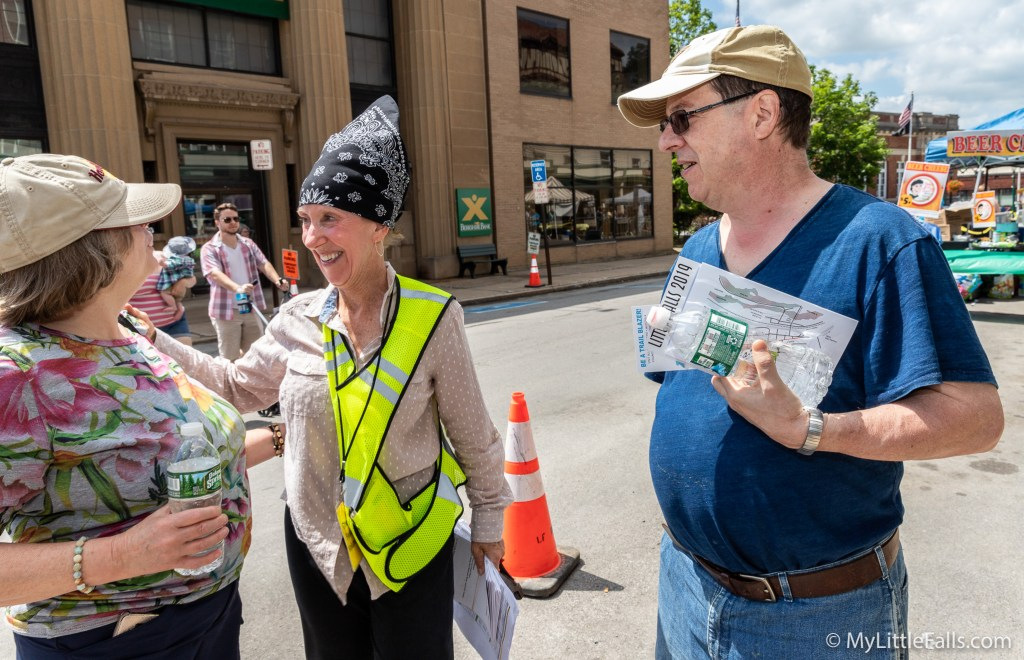 Photo by Dave Warner - Ann Tomei helps out during last year's Cheese Festival.