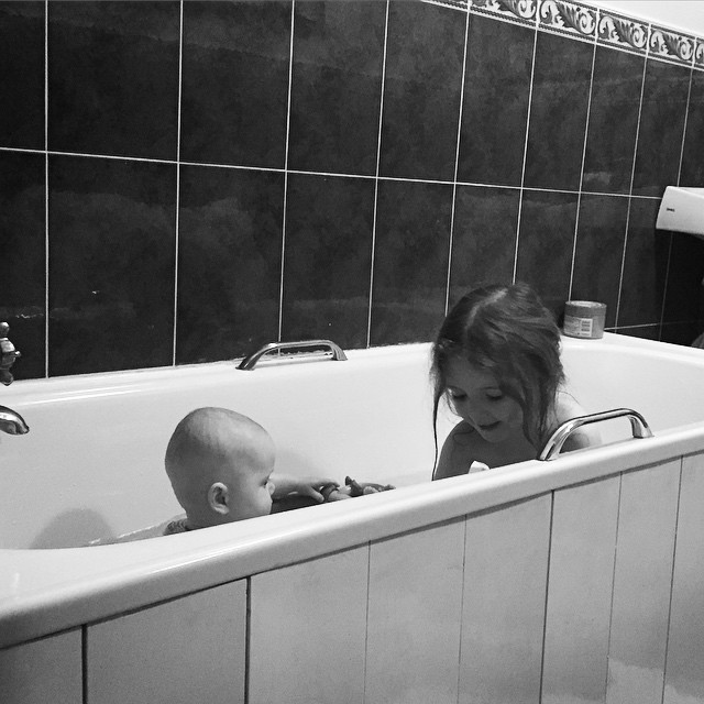 32/365 Taking her big sister duties as serious as ever. She's been desperate for Emily to be big enough to share a bath.