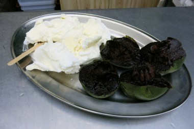 This is chocolate fruit, also name as Black Sapote. The best way to eat the fruit is to wait till is fully ripe and mix it with vanilla ice cream. It will turn into a choclate-ish ice cream, as it has a very similiar taste like chocolate.