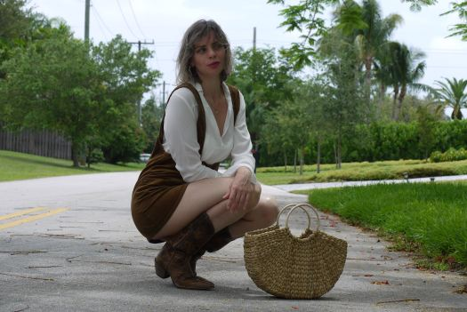 Alba Marina fashion blogger of Mylovelypeople blog is wearing a mini dress jumper + white blouse and cowboys boots in Miami