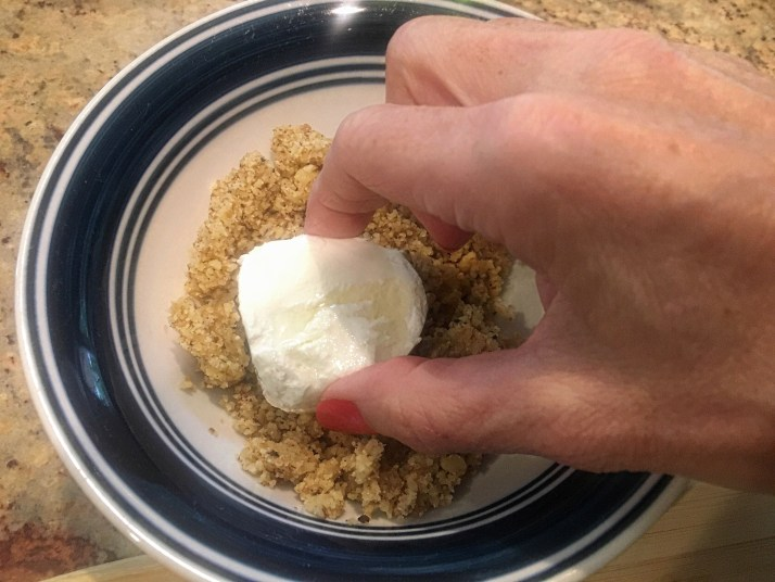 Roll all goat cheese slices in ground walnuts one at a time and coat both sides evenly.