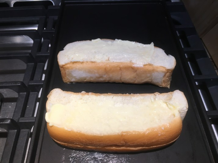 buttered Hot dog buns ready for grilling