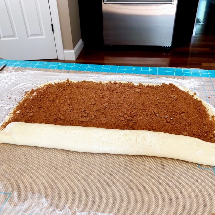 Starting on the long edge, roll the dough and pinch and trim the ends.