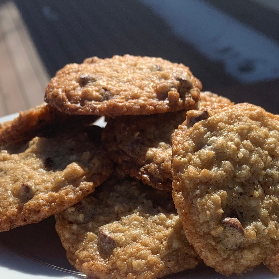 Crispy Oatmeal chocolate chip cookies piled on a plate