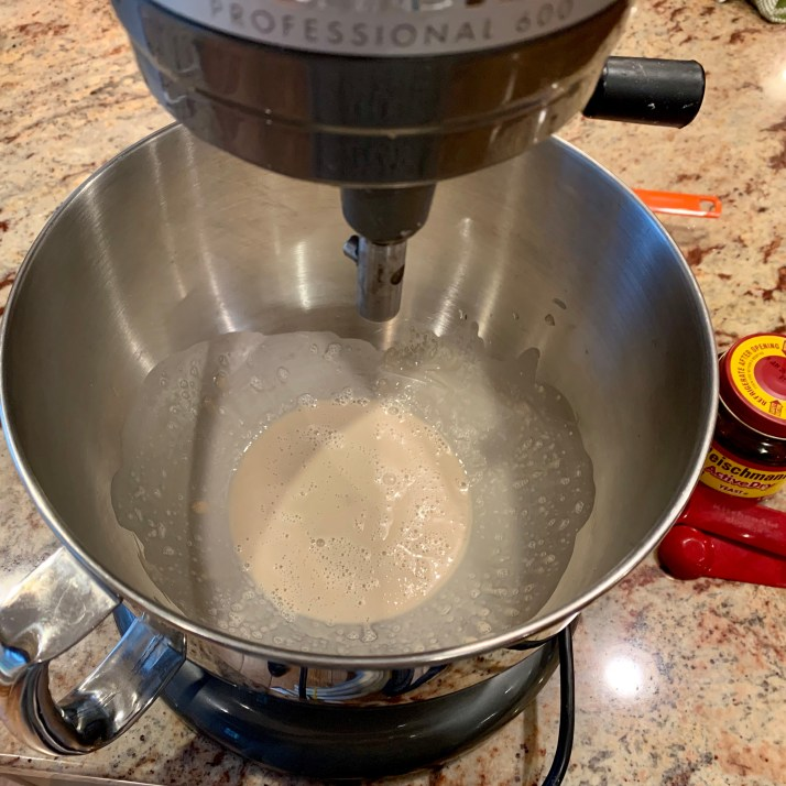 add warm water to large mixing bowl or stand mixer add yeast water water and blend with a fork