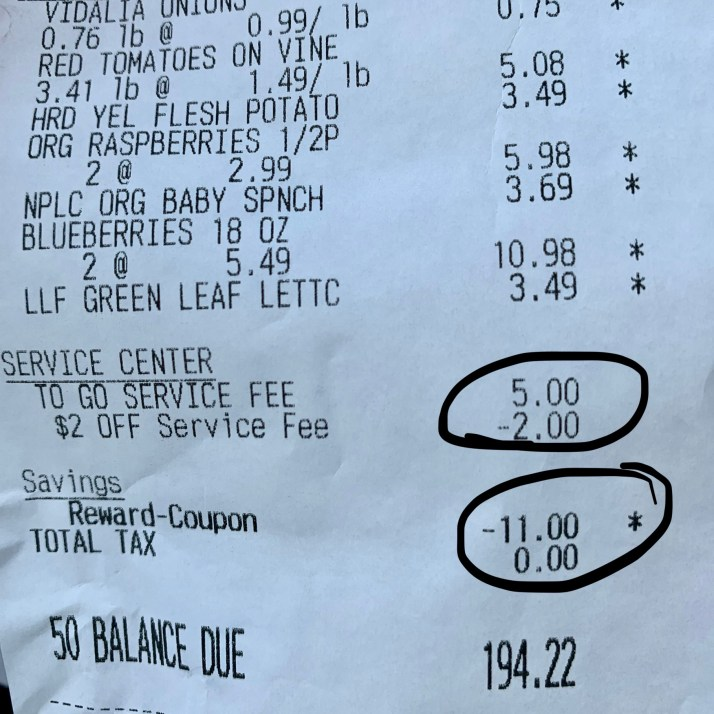 Grocery receipt with discounts circled total discount showing $13.00 deducted from grocery bill.