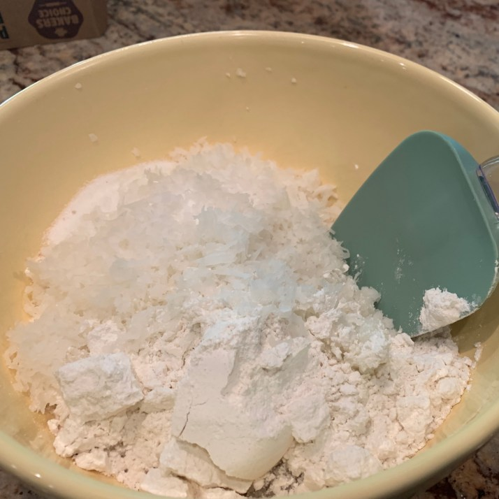 preheat oven to 325 ℉ mix together coconut, flour, sugar and salt in a large mixing bowl