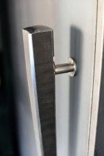 Poigné de portes acier massif frappé