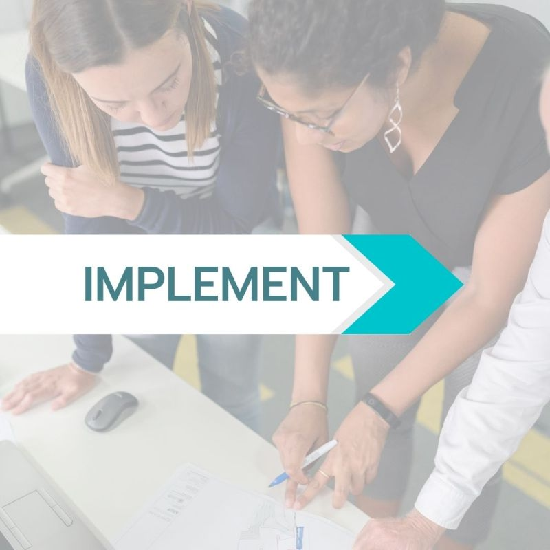 Implement text over a photo of two people reviewing a document together