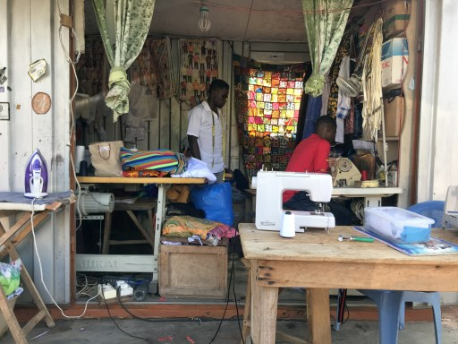 Tailors sewing from a container in Accra Ghana