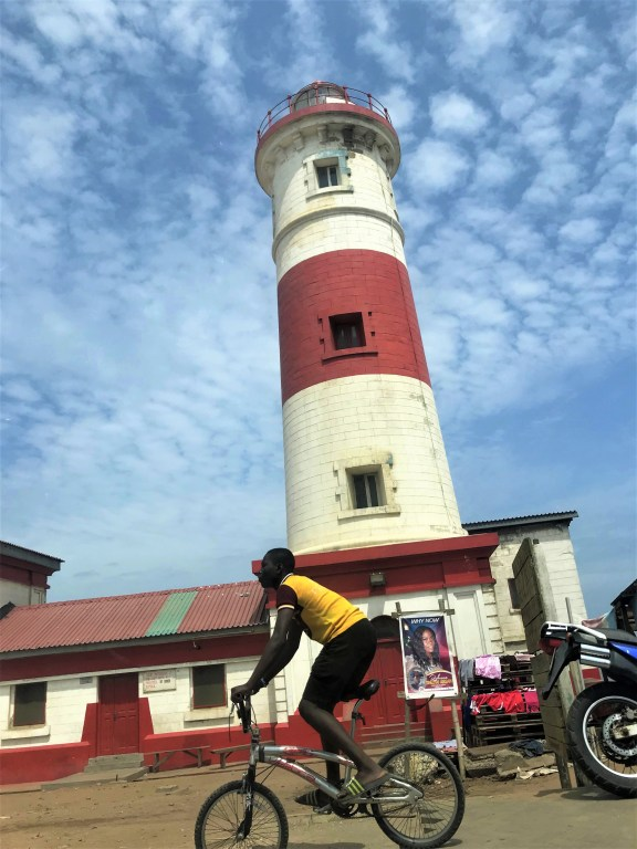 Jamestown Accra lighthouse with man riding a bicycle