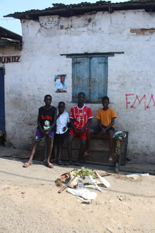 Young boys sitting around at the Ga Twin Festival in Jamestown Accra