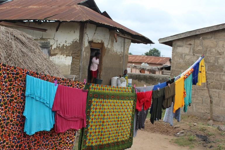 Colourful washing and African wax print fabric hanging in the village in Agortime Kpetoe