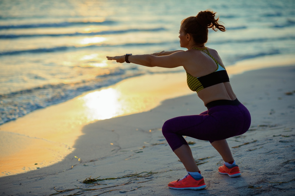 Woman squat on beach