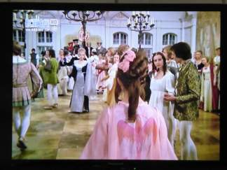 As she enters the ballroom, everyone is stunned about the beautiful stranger