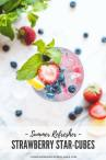 Overhead shot of a glass with a strawberry, mint, and blueberries