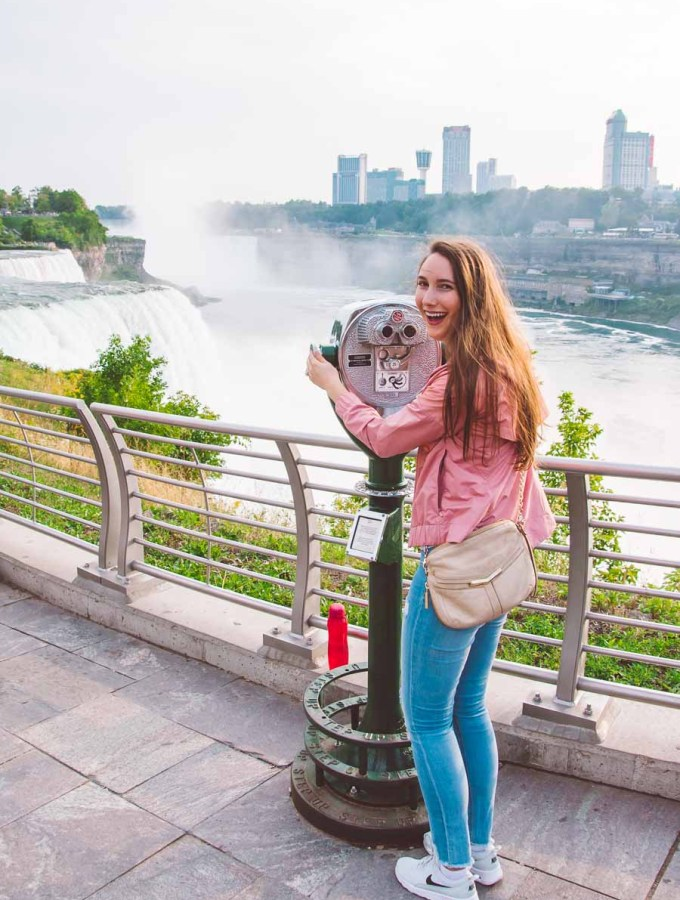 girl in pink jacket looking at Niagara Falls from the US New York side