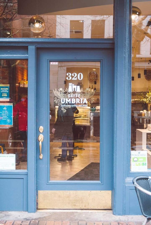 Blue storefront door at Caffe Umbria