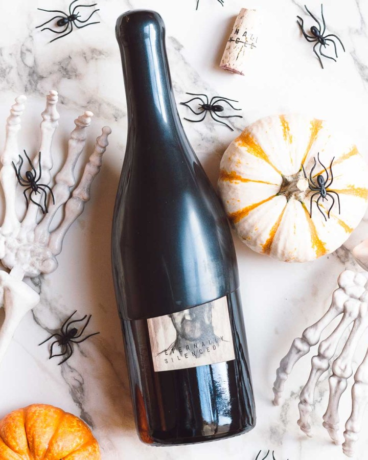 wine bottle surrounded by halloween decorations