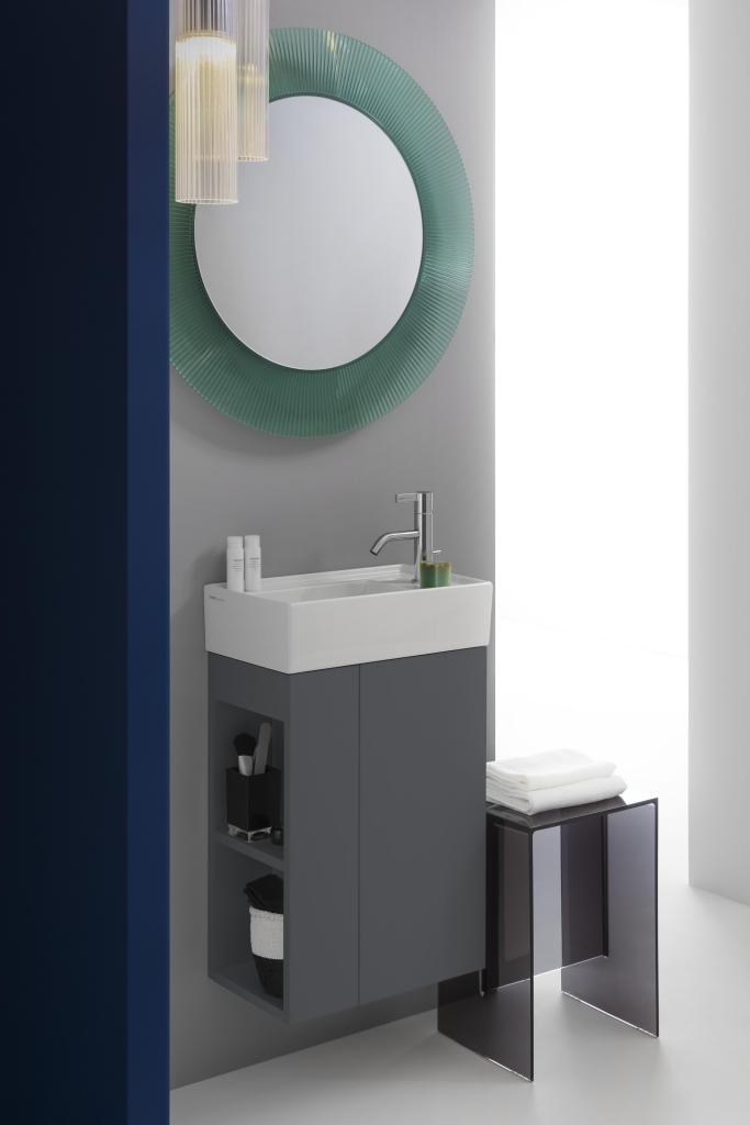 Small white ceramic washbasin by laufen on grey vanity furniture