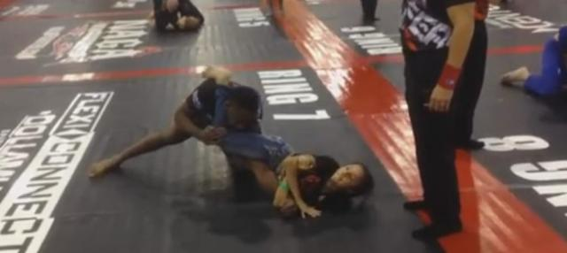 VIDEO:  Jon Jones submitted by young girl at NAGA event