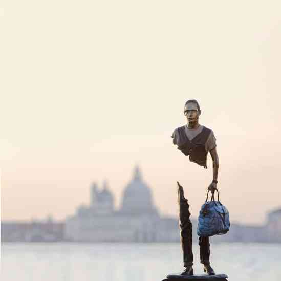 Sculpture of person holding a bag