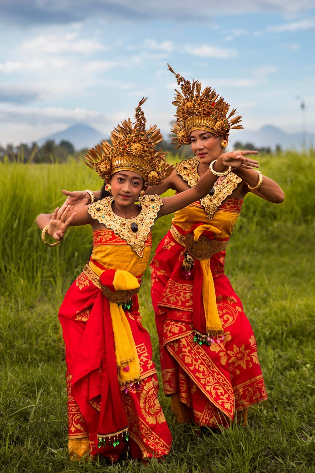Mother and daughter in Bali doing a traditional dance