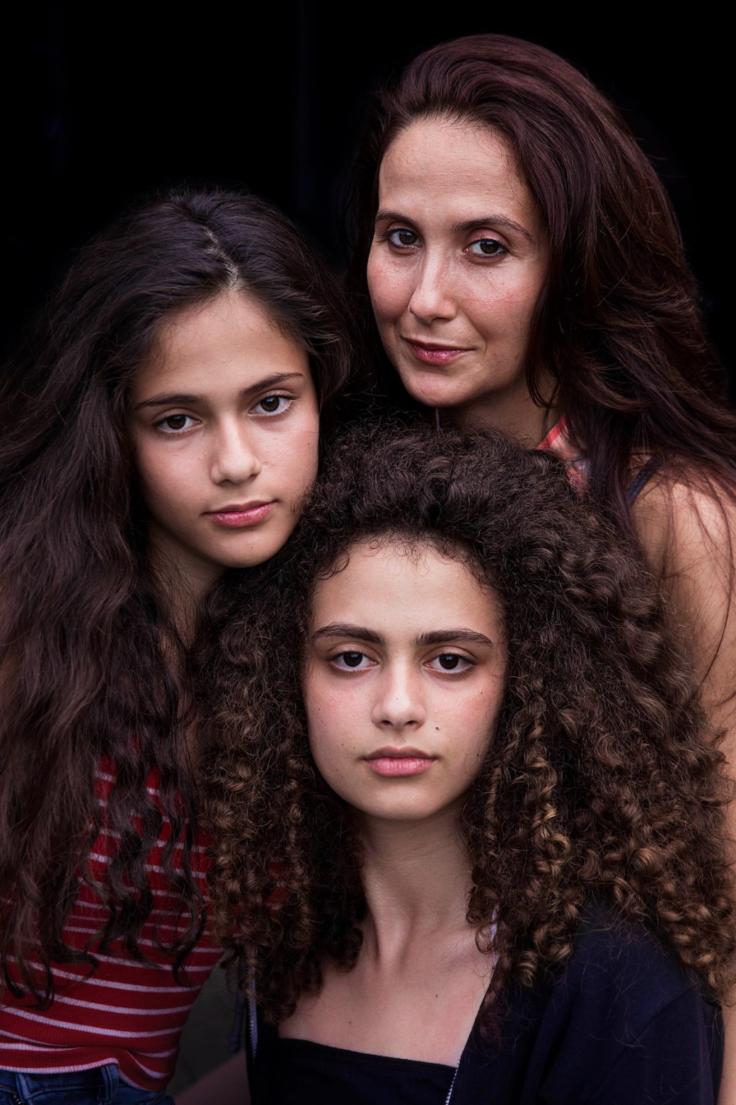 Portrait of a woman with her two daughters in Bucharest