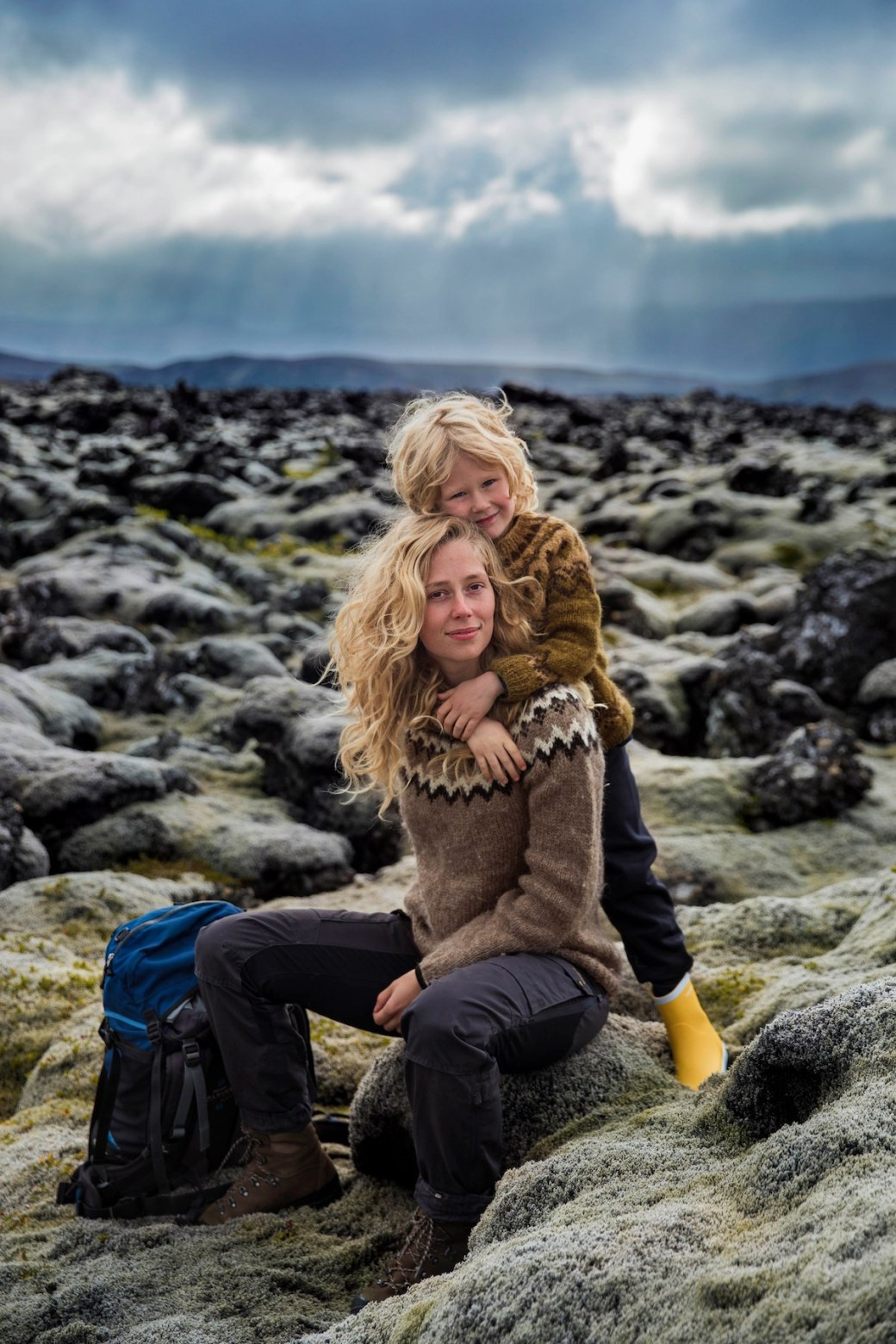 Blond woman with her son in Iceland
