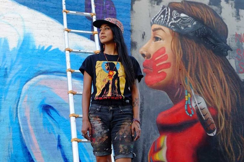 Lucinda Hinojos in Front of Her Mural