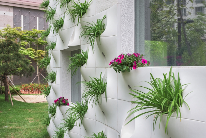 Architects Design Home With Flower Pots Built Into The Exterior Walls