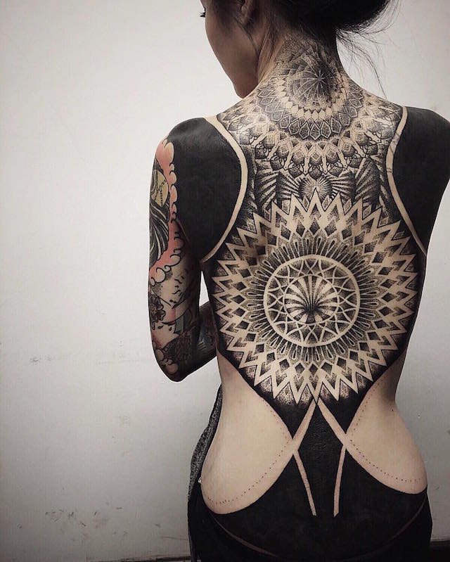 Blackout Tattoo Trend Cloaks the Body in Black Ink to Make a Bold Visual Statement