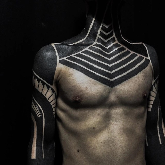 Blackout Tattoo Trend Cloaks The Body In Black Ink To