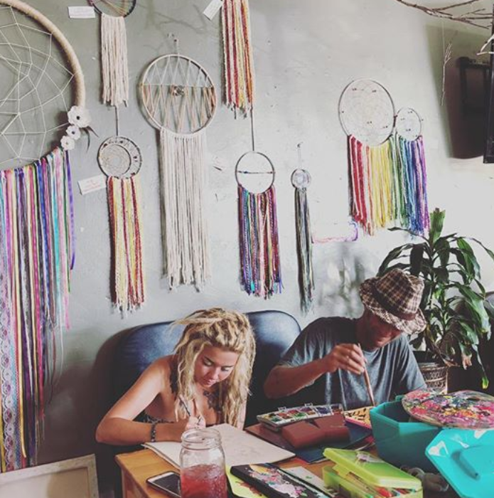 two people coloring at coffee shop