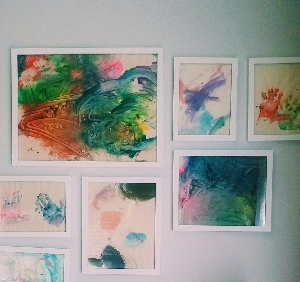 artwork wall with frames, creative ways to display kid artwork
