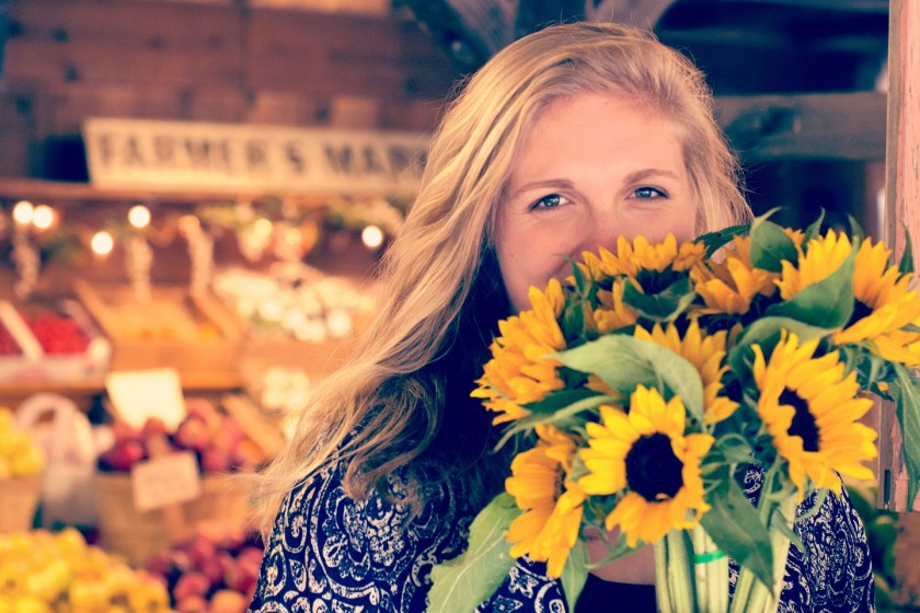 happy woman in flowers, farmers market tips
