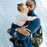 stepdad holding child feeling happy