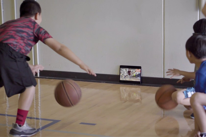 happy kid playing basketball online