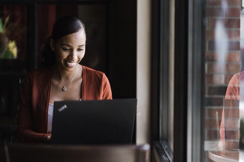happy woman smiling at computer