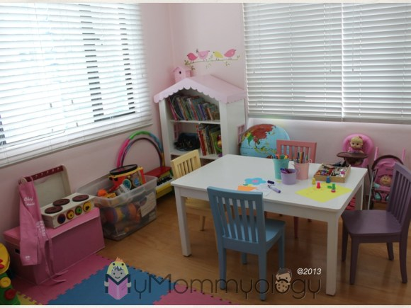 c/o Two Tots from L to R: Personalized Apron, White blinds, Dollhouse bookshelf, Table and chairs set.  And painting it pink!
