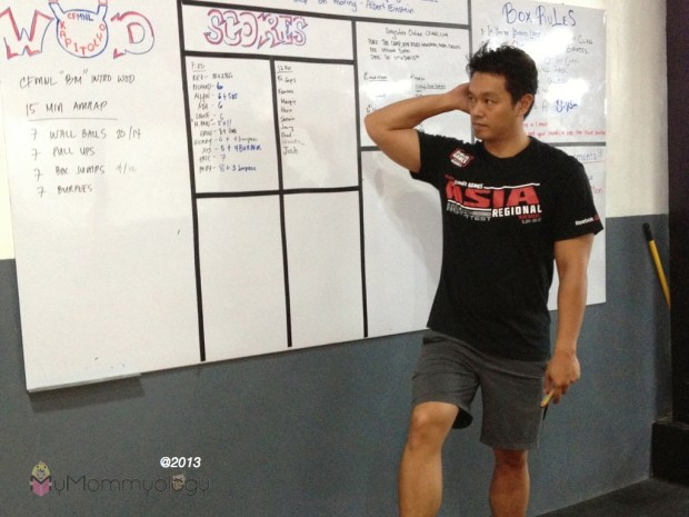 """I call him the """"CrossFit God"""", Coach Miggy giving a rundown of the day's WOD (I'll explain later)."""