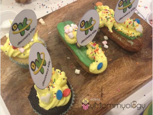Back cupcake: Jamie's marshmallow Bunny.  Choc cupcake: Princess Flowerpower.  Middle Eclair:  Marshmallow Starpower.  Last Eclair:  Fairy Sailboat
