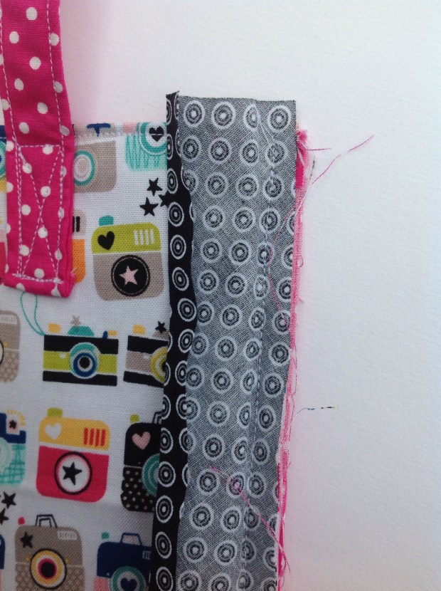 Sewing the bag panels together with the binding