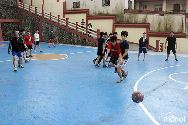 students-chasing-ball