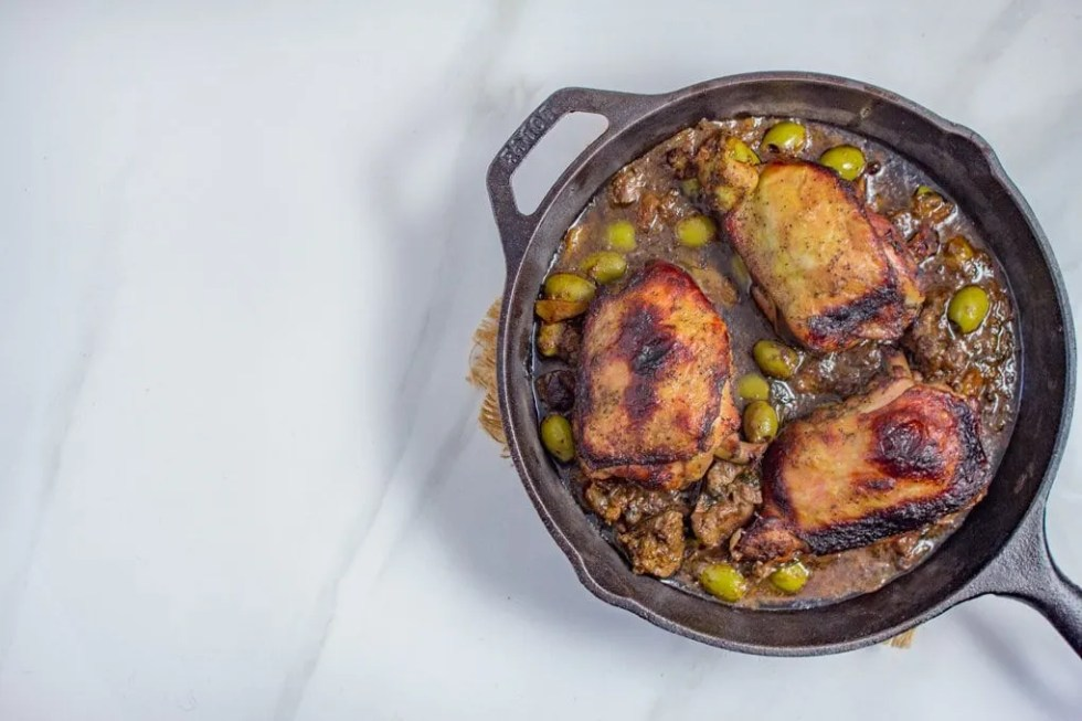 Djaj Mqualli | Moroccan Roasted Lemon & Olives Chicken | Loaded with Citrus, Olives and Creamy Chicken Livers, this Moroccan Rotisserie Style Chicken is a memorable dish to make. #Moroccan #Recipe #Moroccanfood #lemonchicken #tagine